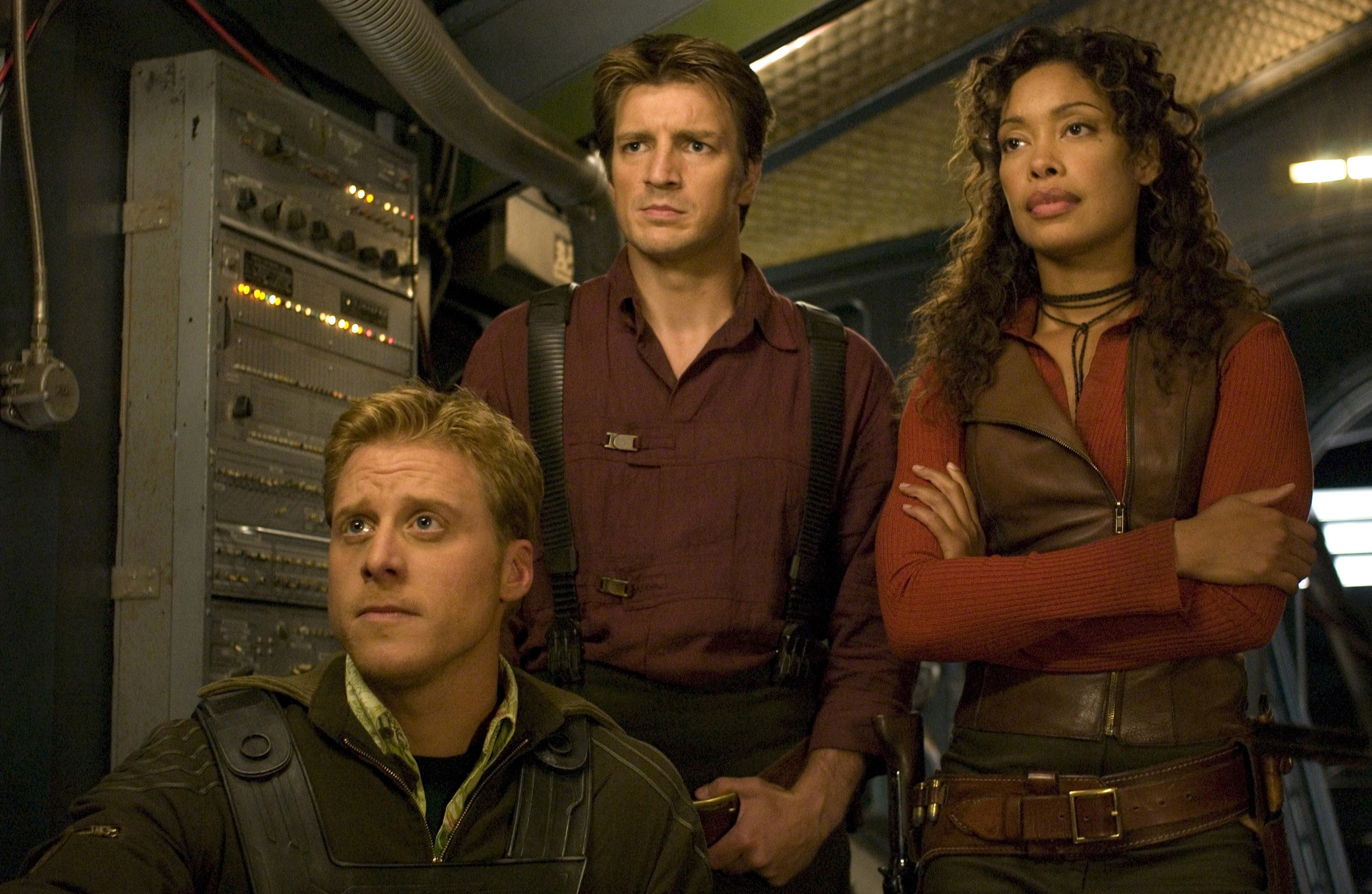 L-R:Alan Tudyk, Nathan Fillion, and Gina Torres in the movie SERENITY. photo by Sidney Baldwin. Universal Studios
